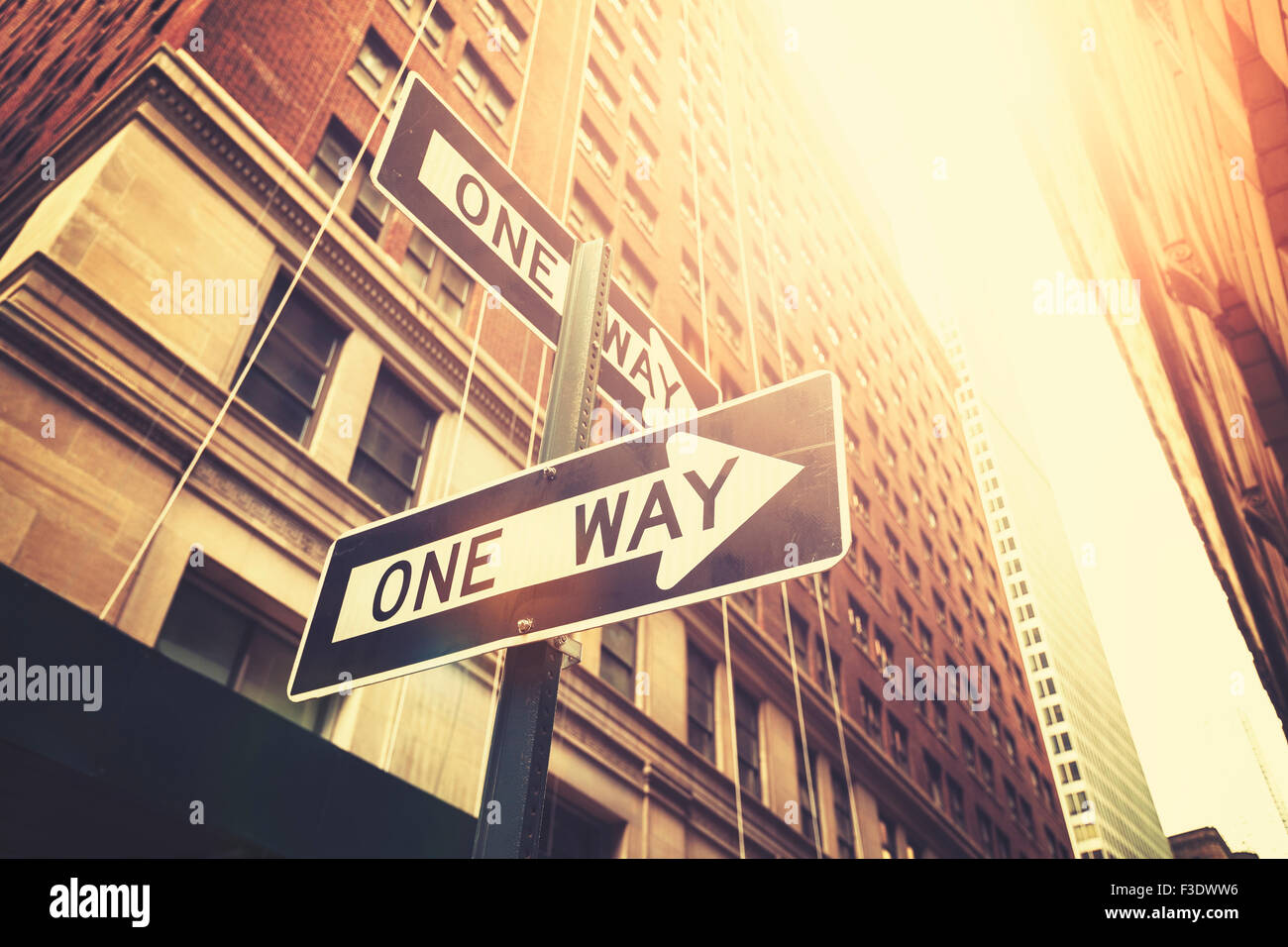 Retro style 'one way' signs on street of Manhattan, shallow depth of field, New York, USA. - Stock Image