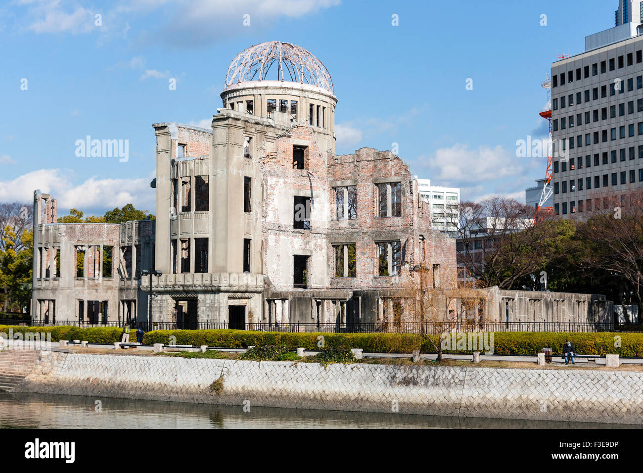 Hiroshima, Japan, A-bomb dome, ruined building near ground zero, sunlight and blue skies, winter time - Stock Image