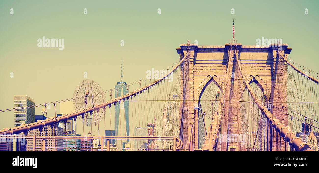 Vintage filtered panoramic picture of Brooklyn Bridge in New York City, USA - Stock Image