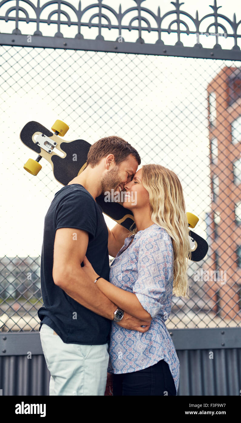 Couple missed each other and meet in city environment - Stock Image