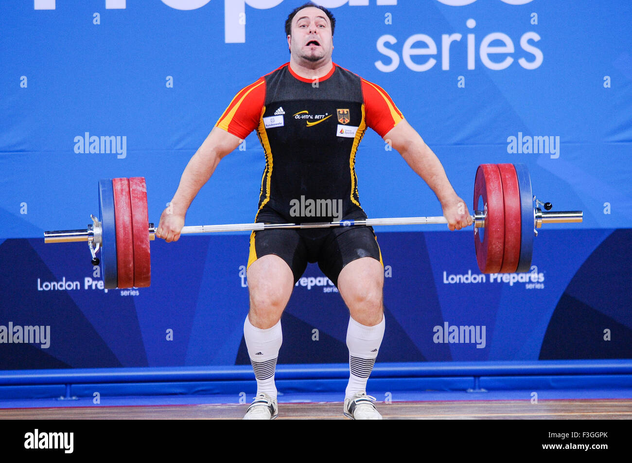 Almir  VELAGIC (FRA) in the snatch, The London Prepares Weightlifting Olympic Test Event, ExCel Arena, London, England - Stock Image