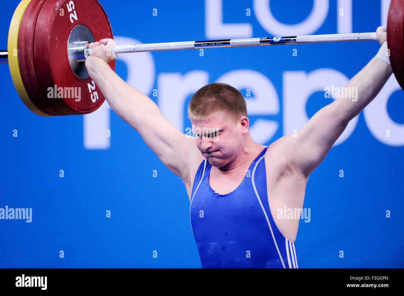 Dmityiy  KAPLIN (KAZ) in the snatch, The London Prepares Weightlifting Olympic Test Event, ExCel Arena, London, - Stock Image