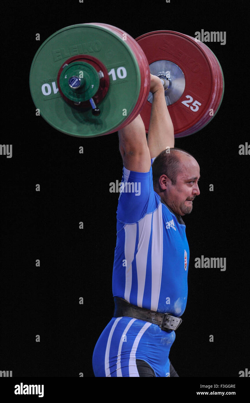 Ferenc GYURKOVICS (HUN) in the clean and jerk, The London Prepares Weightlifting Olympic Test Event, ExCel Arena, - Stock Image