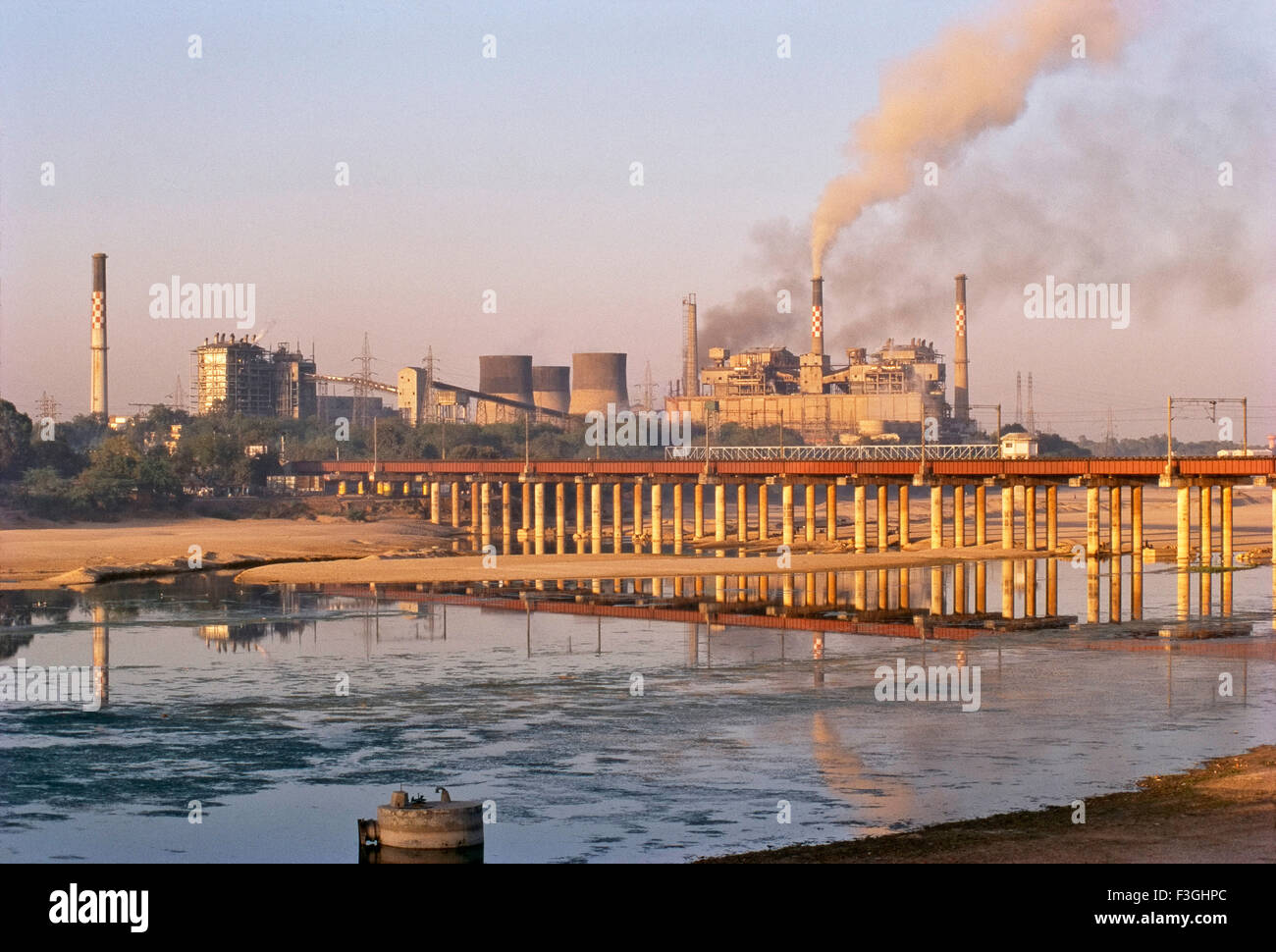 Power station, Thermal power plant on the banks of river Sabarmati , Torrent Power station, Ahmedabad , Gujarat Stock Photo