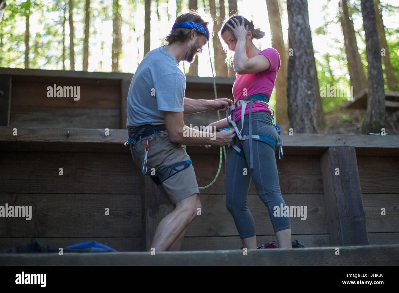Couple preparing for rock climbing, French's Dome, Zig Zag, Oregon, USA - Stock Image