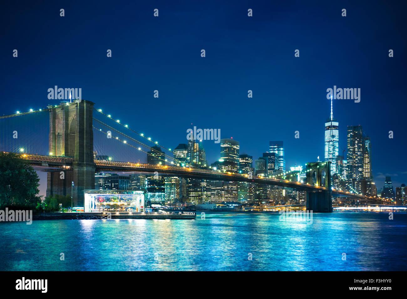 Beautiful night view of the Brooklyn Bridge looking towards Manhattan New York City - Stock Image