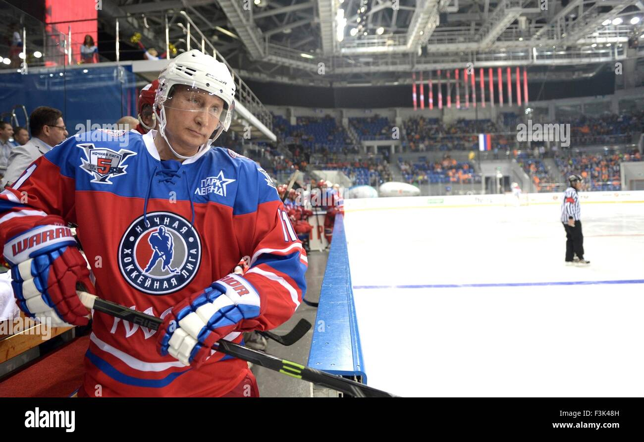 Russian President Vladimir Putin waits to get on the ice during the annual ice hockey match between former NHL stars - Stock Image