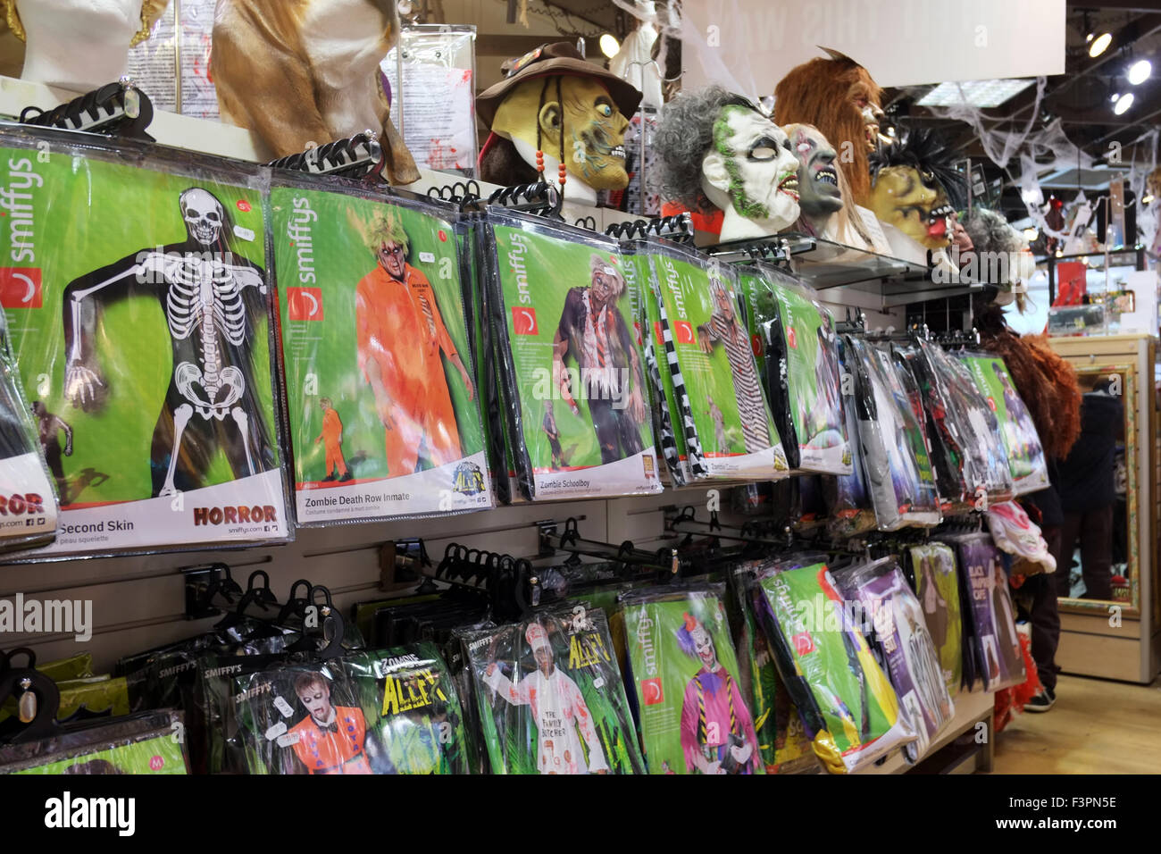 halloween costumes & masks on display with seasonal offers for sale