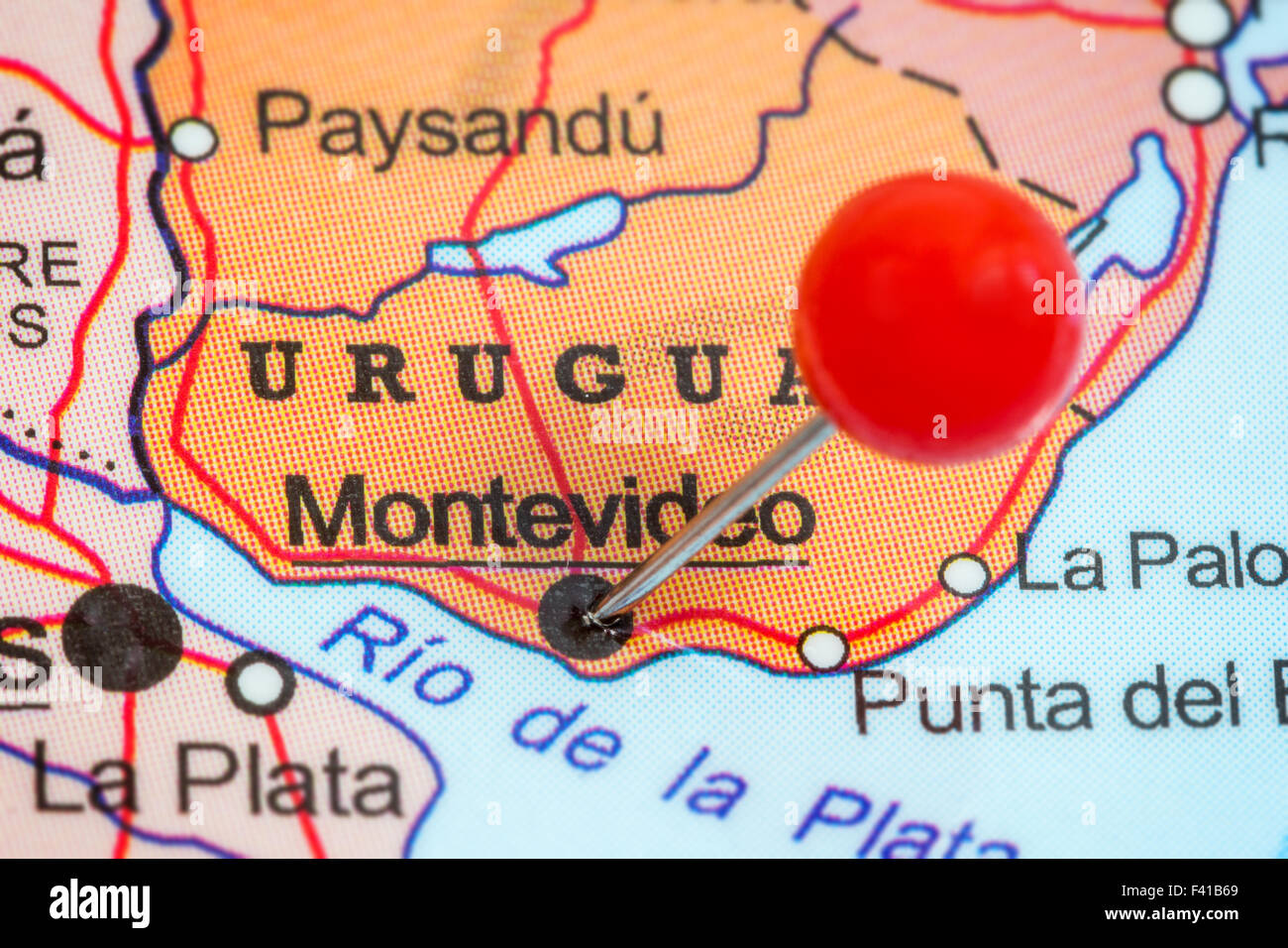Close-up of a red pushpin in a map of Montevideo, Uruguay. - Stock Image
