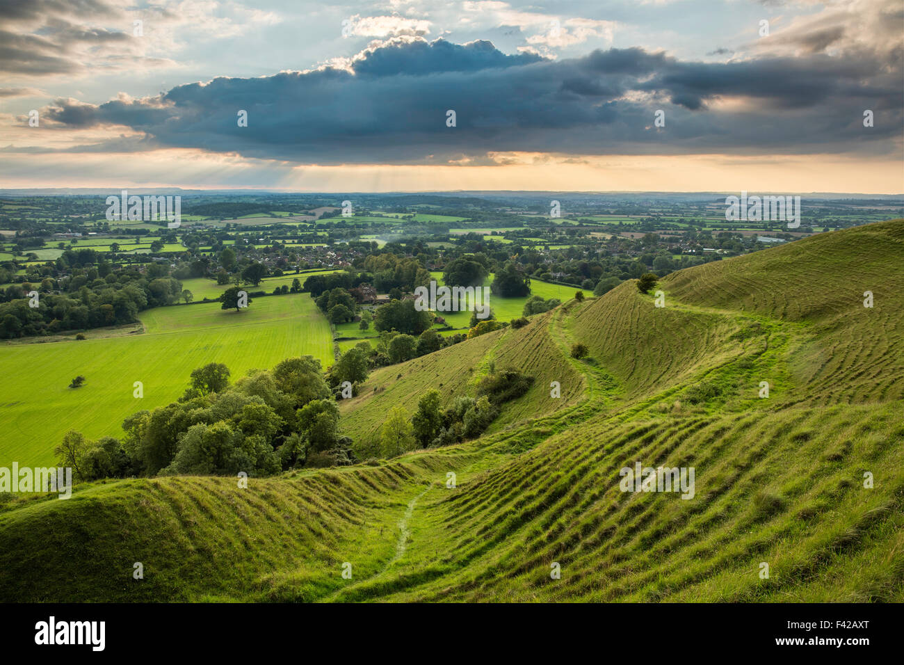 the ramparts of the prehistoric hill fort on Hambledon Hill above the Blackmore Vale, Dorset, England, UK - Stock Image