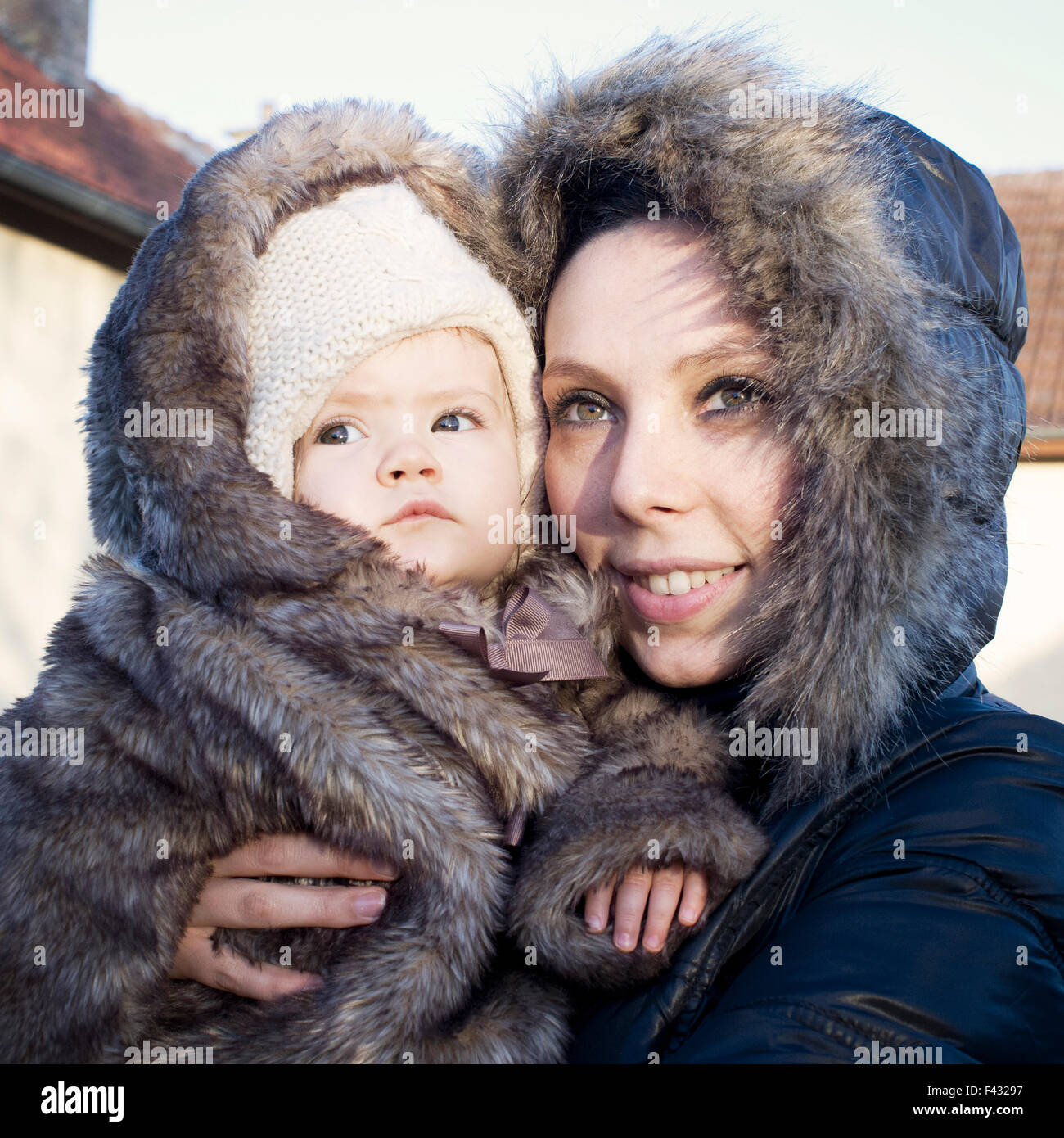 3d120489ecee4 Mother and baby dressed in winter coats, portrait Stock Photo ...