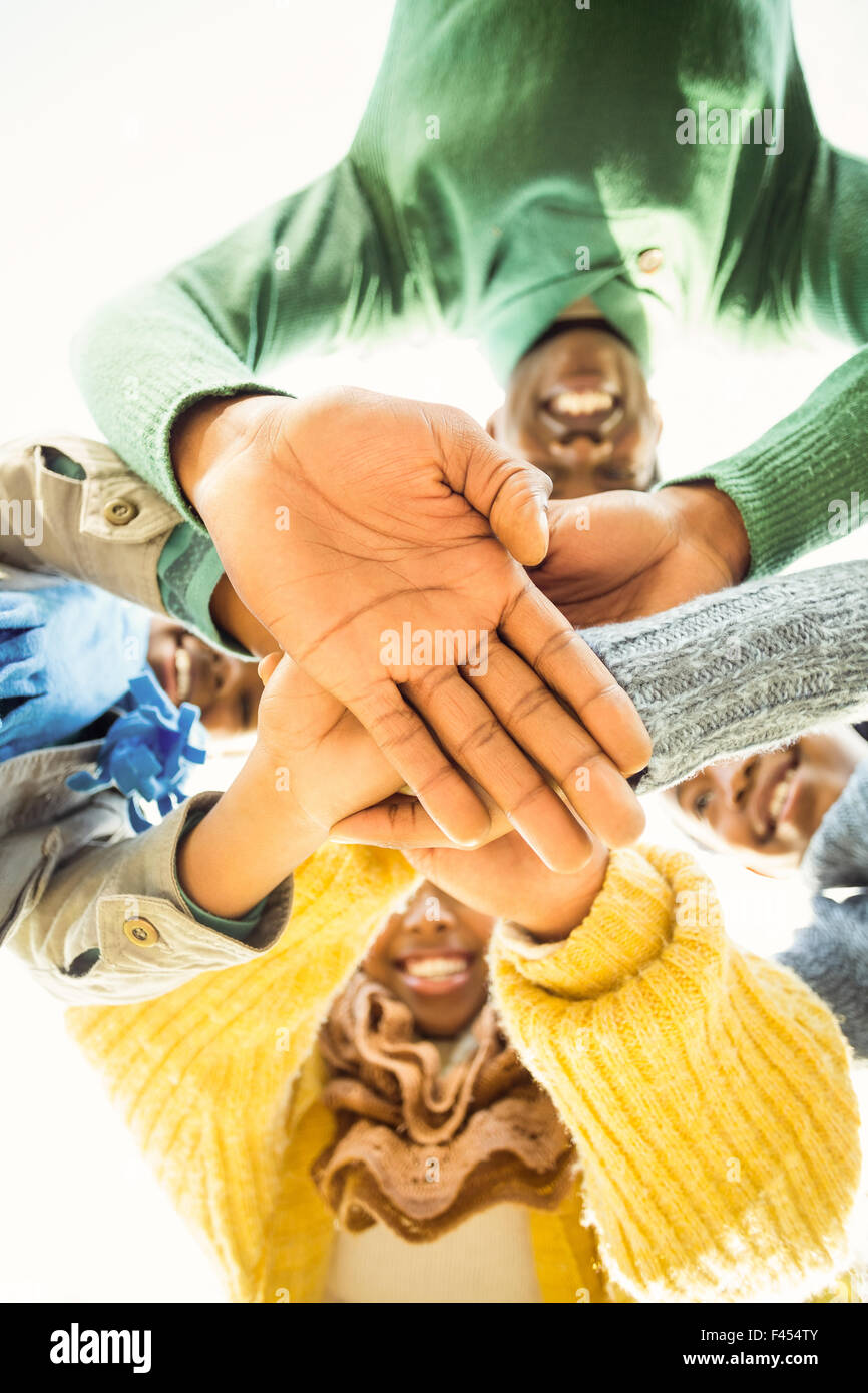 Young family doing a head circles and joining their hands - Stock Image