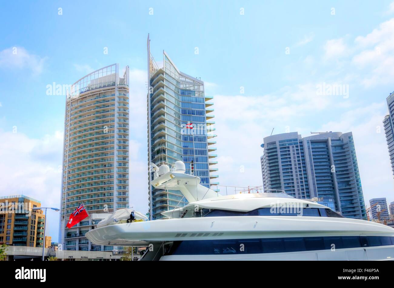 A view of a yacht and towers at the beautiful Marina in Zaitunay Bay in Beirut, Lebanon. A very modern, high end - Stock Image