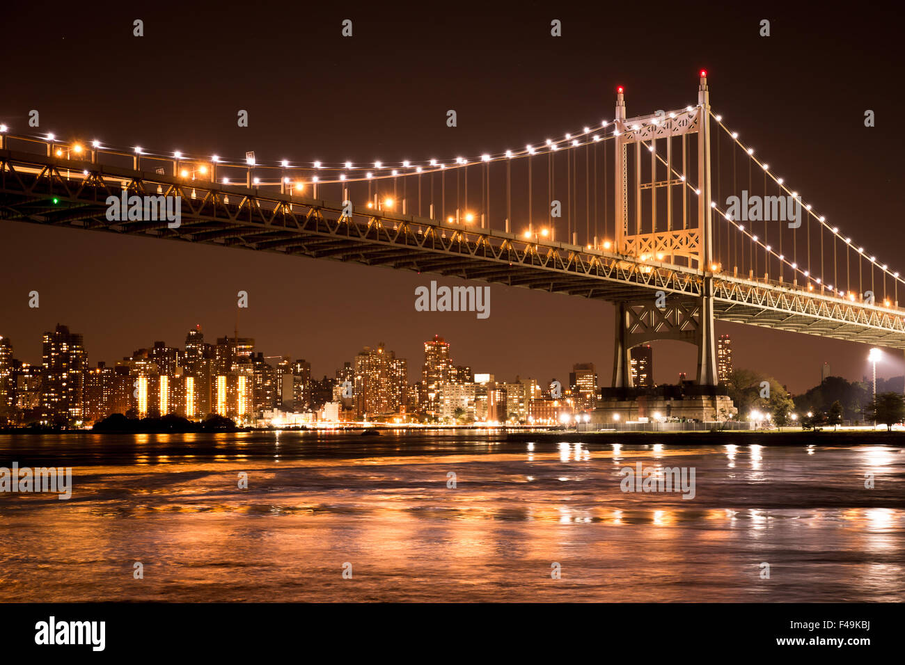 Beautiful view of the Ed Koch Queensboro Bridge in New York City looking towards Manhattan at night - Stock Image