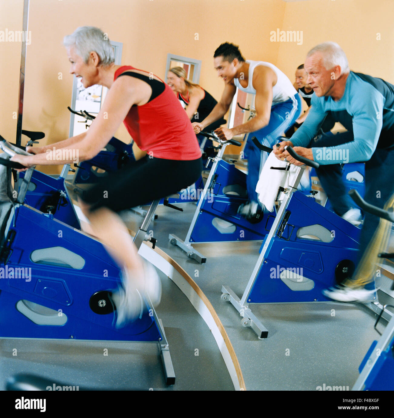 20-24 years 30-34 years activity adults only athlete bicycle bodybuilding color image cycle exercising five people - Stock Image