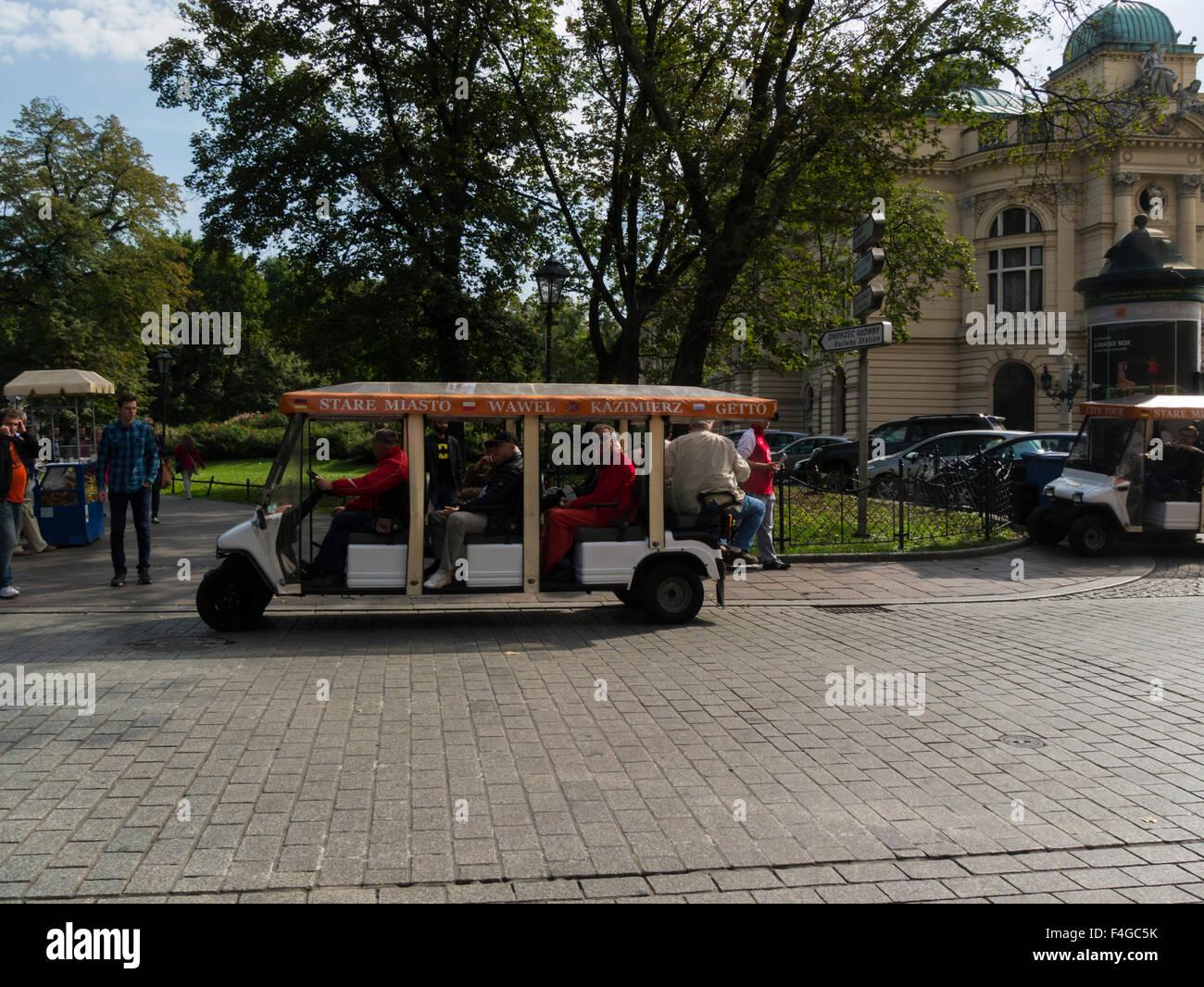 Pollution free Electric carriage taking tourists on Krakow Old City tour Poland environmentally friendly tourist - Stock Image