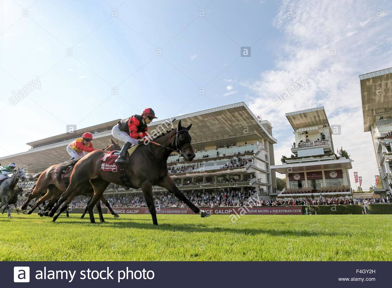 Paris, France. October 3rd, 2015. FRANCE, Paris: French jockey Vincent Cheminaud (C) is about to win Qatar Grand Stock Photo