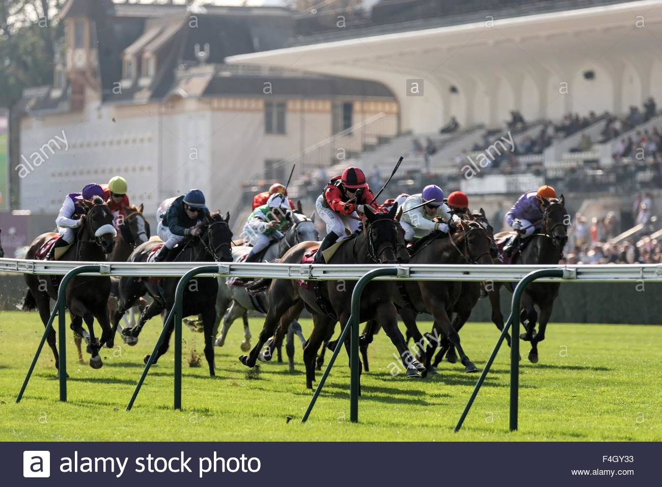 Paris, France. October 3rd, 2015. FRANCE, Paris: Jockeys get on horses during 94th Prix de l'Arc de Triomphe held Stock Photo