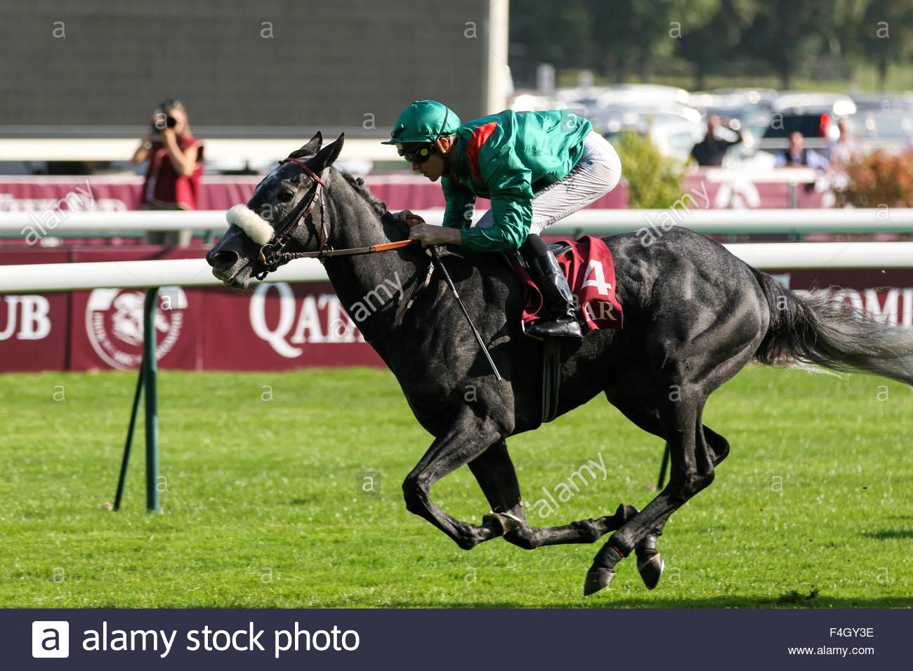 Paris, France. October 3rd, 2015. FRANCE, Paris: A jockey gets on a horse during 94th Prix de l'Arc de Triomphe Stock Photo