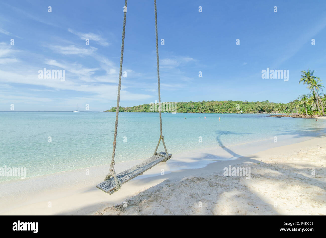 Summer, Travel, Vacation and Holiday concept - Swing hang from coconut palm tree over beach sea in Phuket ,Thailand. - Stock Image