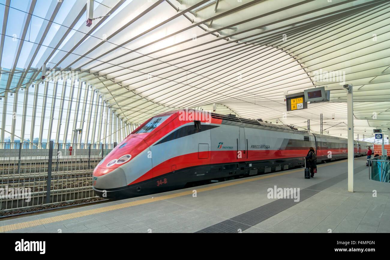 train and passengers in High Speed Train Station in Reggio Emilia, Italy. - Stock Image