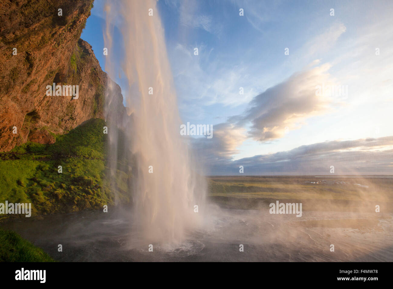 Seljalandsfoss waterfall plunging 60m from the cliff above, Sudhurland, Iceland. - Stock Image