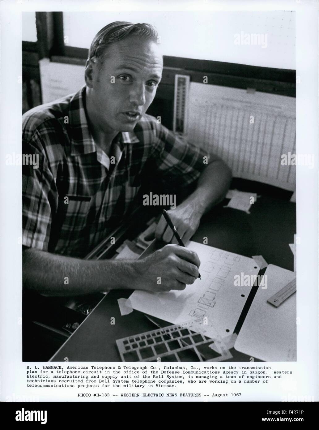 1964 - R. L. HANKACK, American Telephone & Telegraph Co., Columbus, Ga., works on the transmission plan for - Stock Image