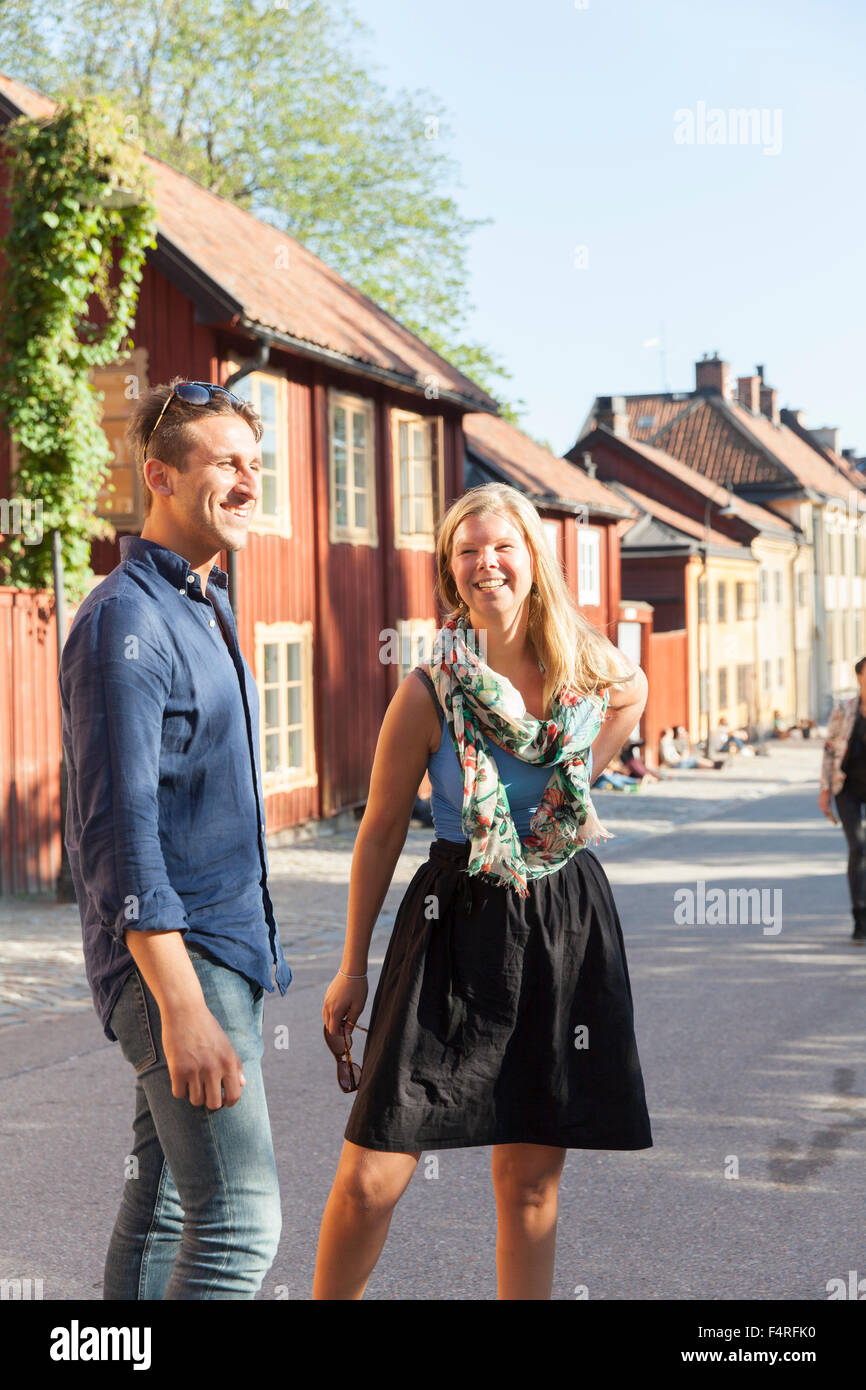 Sweden, Sodermanland, Sodermalm, Stockholm, Cheerful couple on street - Stock Image