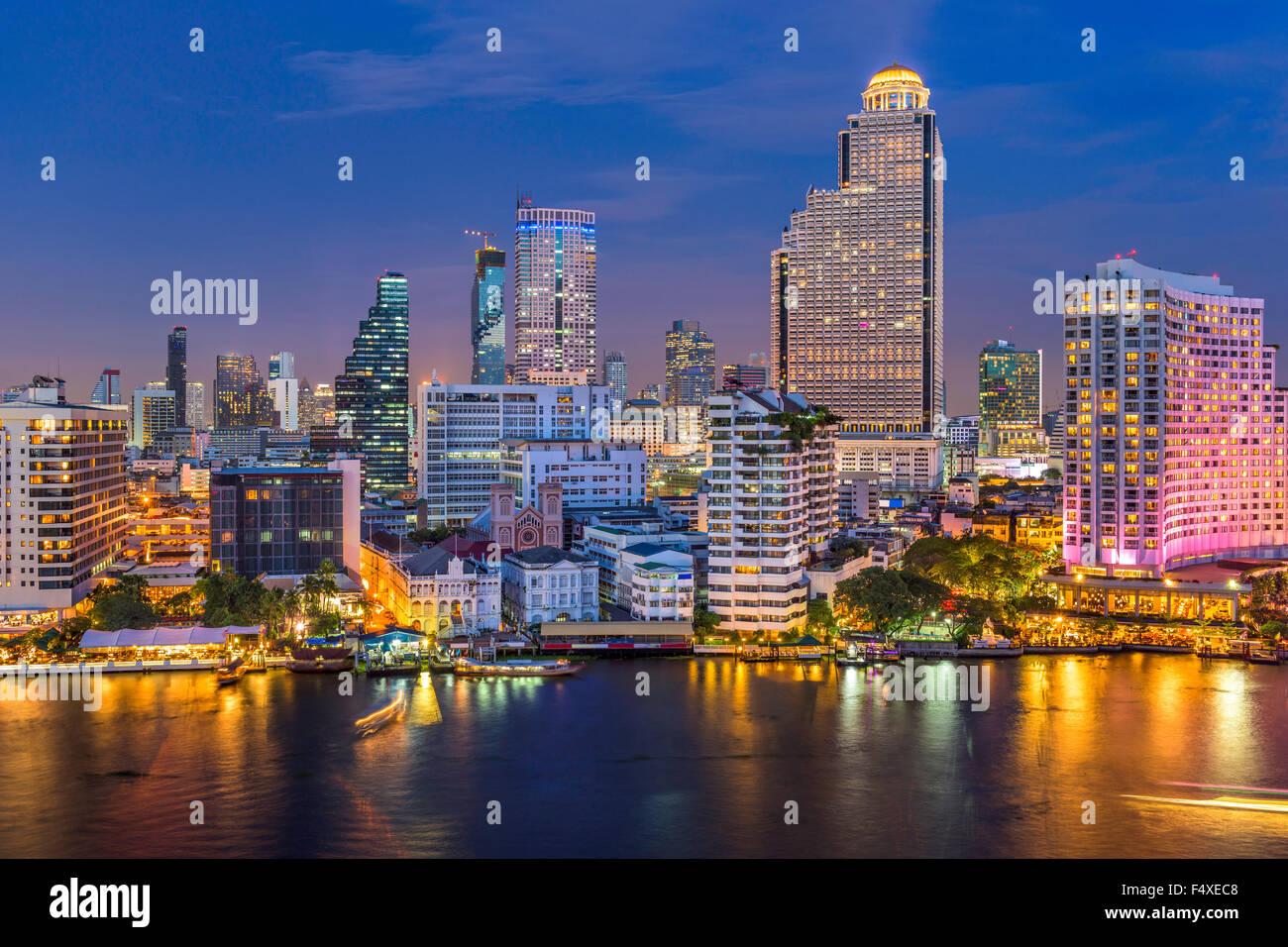 Bangkok, Thailand skyline on the Chao Phraya River. - Stock Image