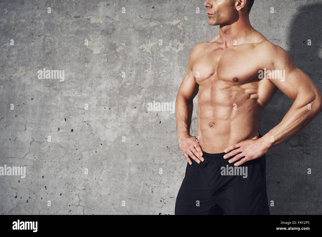 Fitness portrait half body six pack no shirt, fitness concept, room for copyspace, fit and healthy muscular male - Stock Image