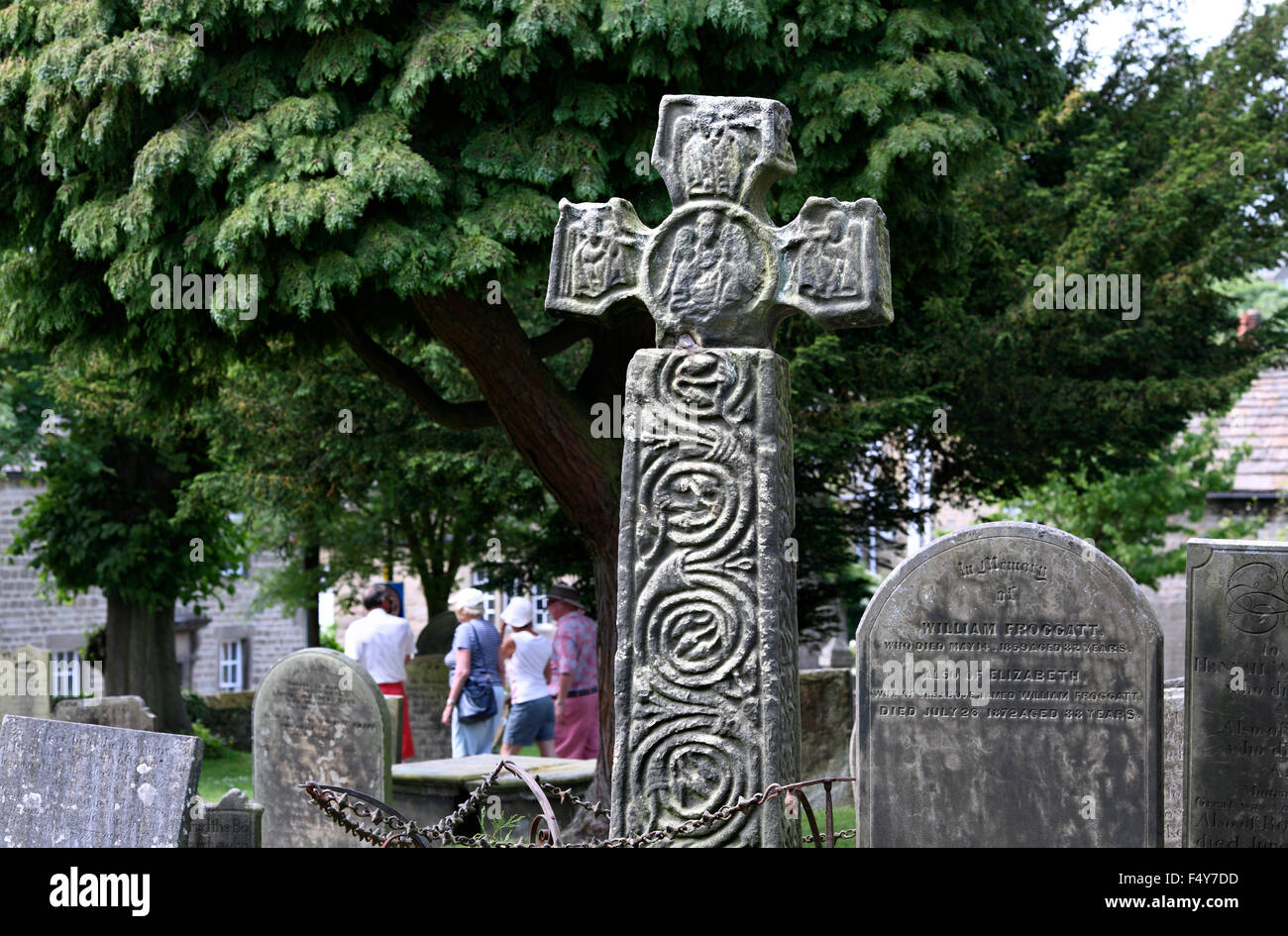 Eyam Cross, an early 9th century Saxon stone cross in the churchyard of St Lawrence's Church, Eyam, Derbyshire. - Stock Image