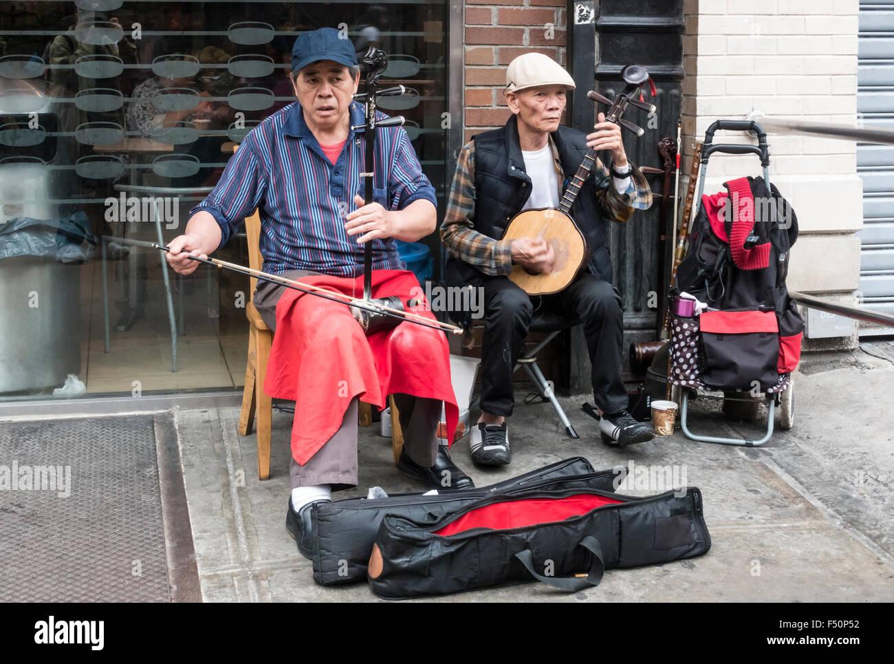 two-senior-asian-busker-musicians-playin