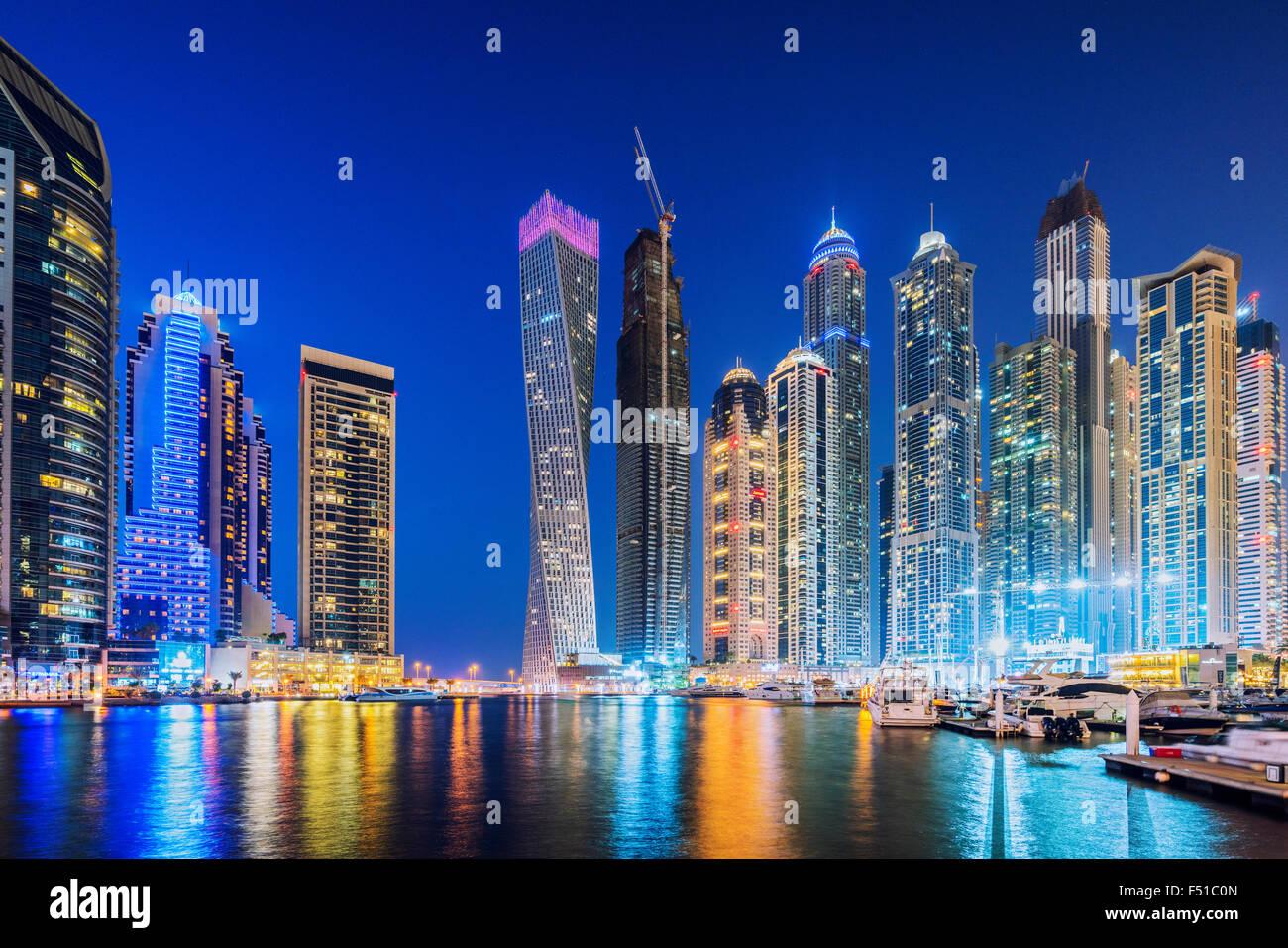 Skyline of skyscrapers  at night in  Marina district of Dubai United Arab Emirates - Stock Image