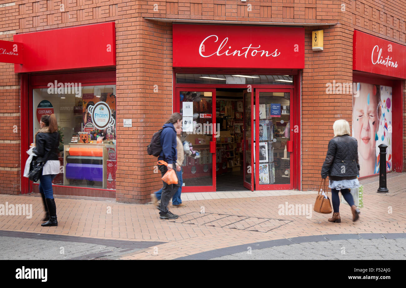 Clintons; Passing by Clinton Cards retail gift store business. Clintons corner shop, in Victoria St, town centre Stock Photo
