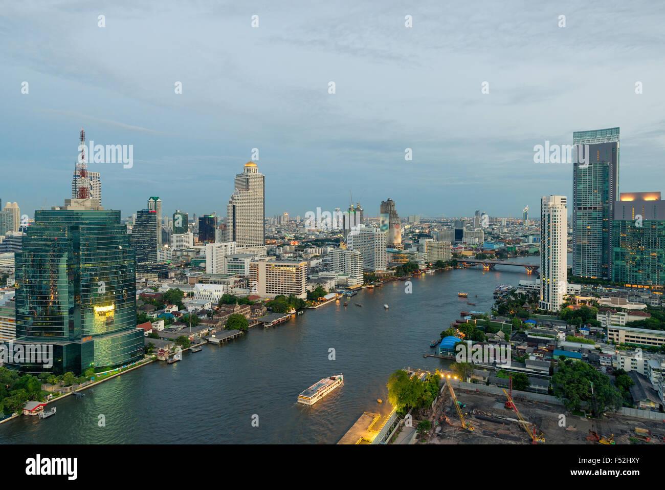 Beautiful skyline along Chao Phraya River in Bangkok at dusk , Thailand - Stock Image