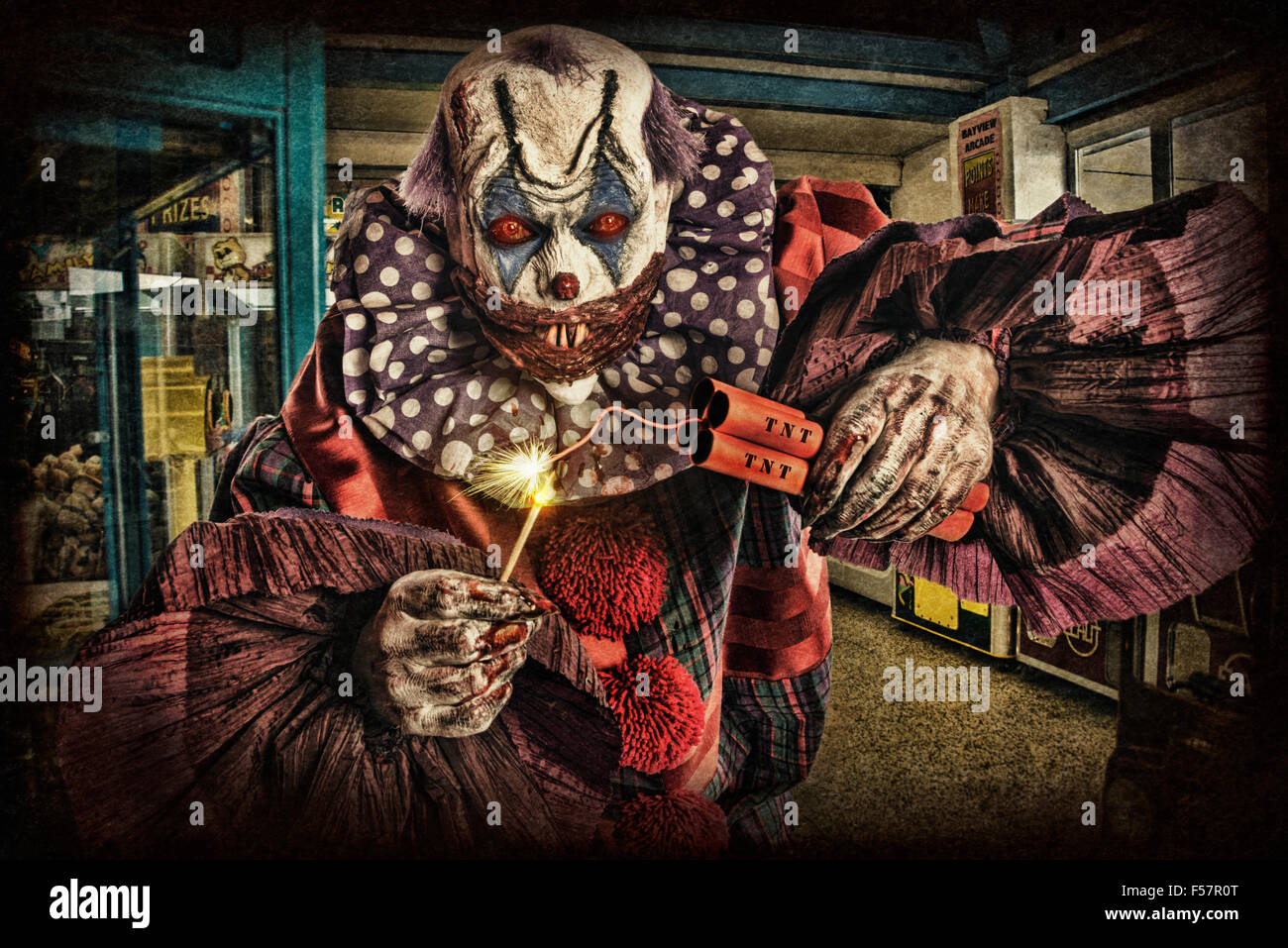 Scary creepy clown with TNT/Dynamite, - Stock Image