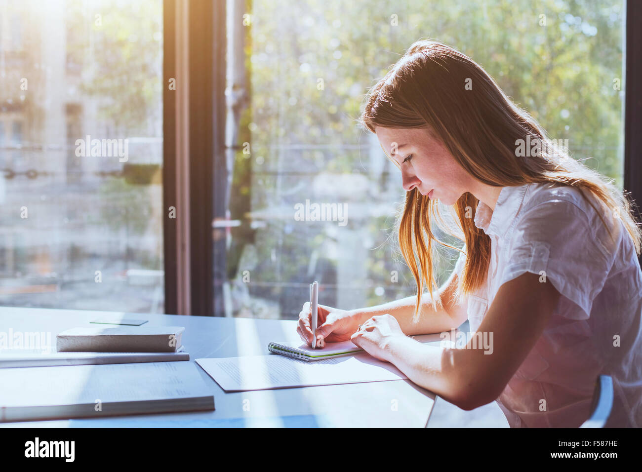 student in classroom during exam - Stock Image