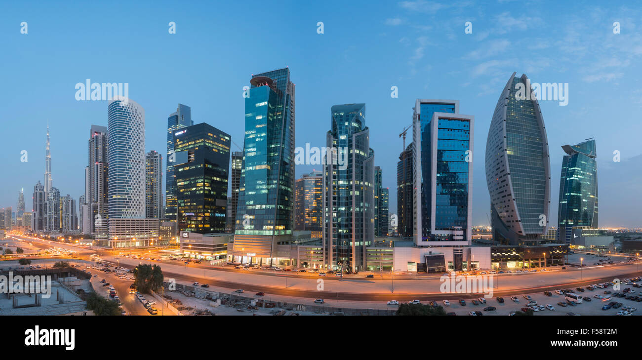 Skyline panorama of new office towers at night  in Business Bay district of Dubai United Arab Emirates - Stock Image