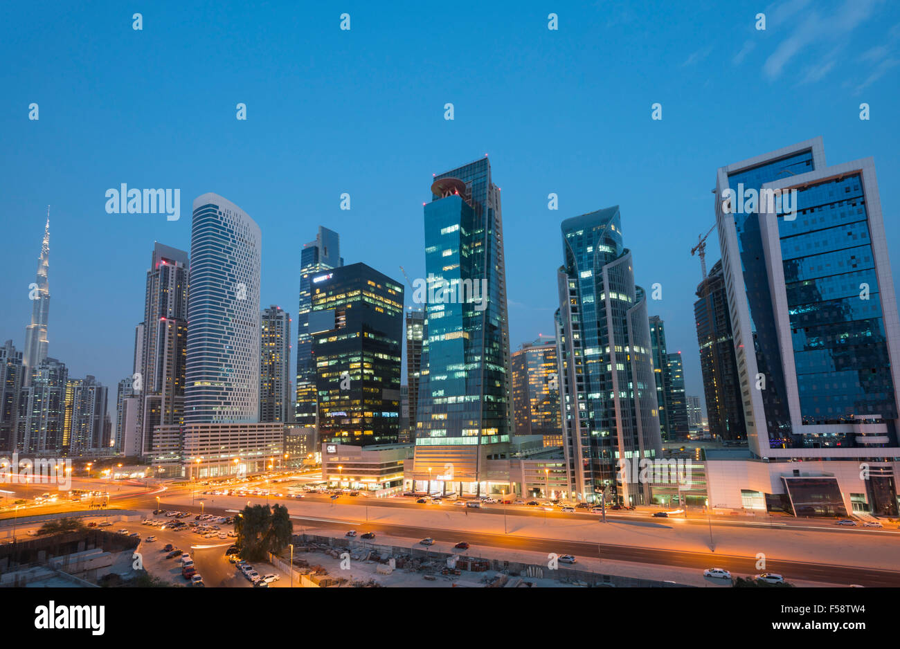 Skyline of new office towers at night  in Business Bay district of Dubai United Arab Emirates - Stock Image