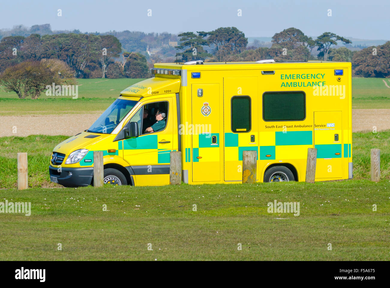 NHS South East Coast Ambulance parked by some grass while the crew take a break., in South East England, UK. - Stock Image