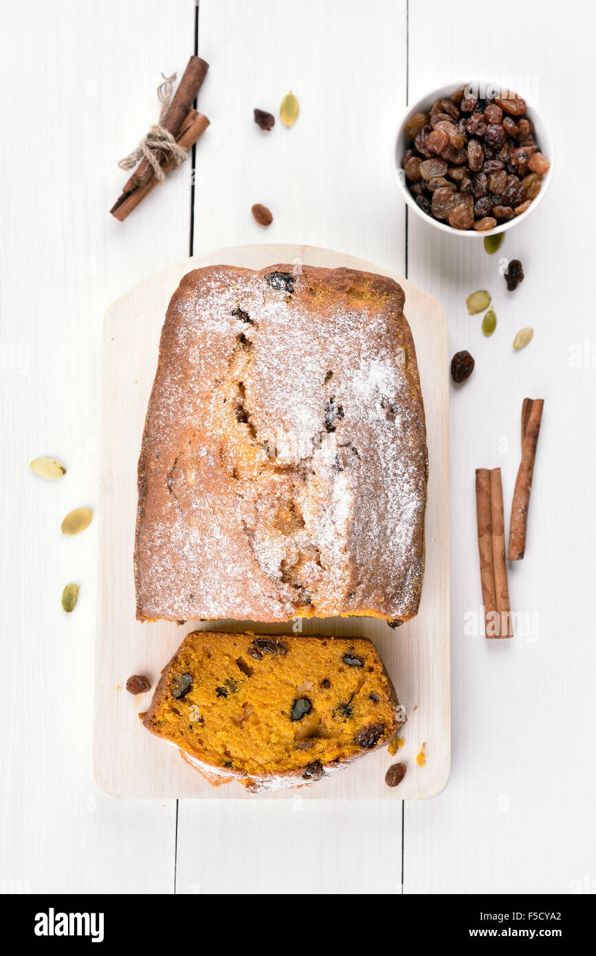 Pumpkin bread and ingredients on white wooden table, top view - Stock Image
