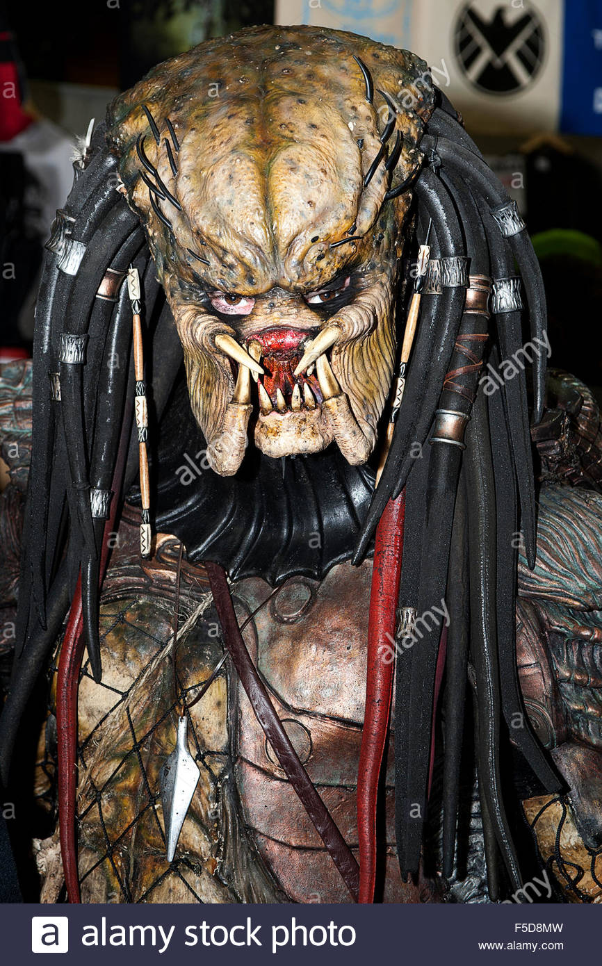 An actor dressed in a Predator costume, at a comicon event held at Newcastle Arena, England,U.K. - Stock Image