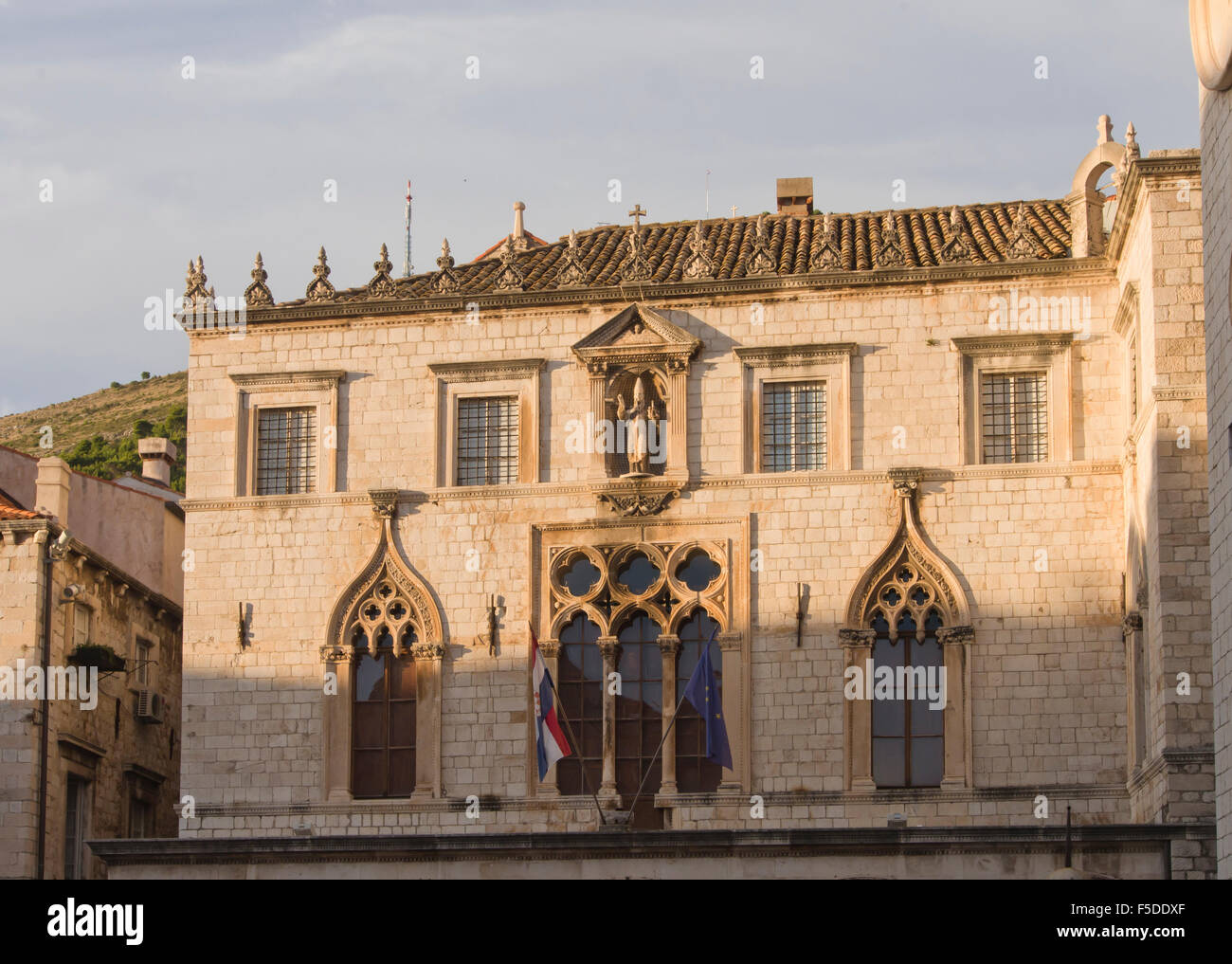 Sunset on the facade of the Sponza Palace in the historical old town in Dubrovnik Croatia a Unesco World Heritage - Stock Image