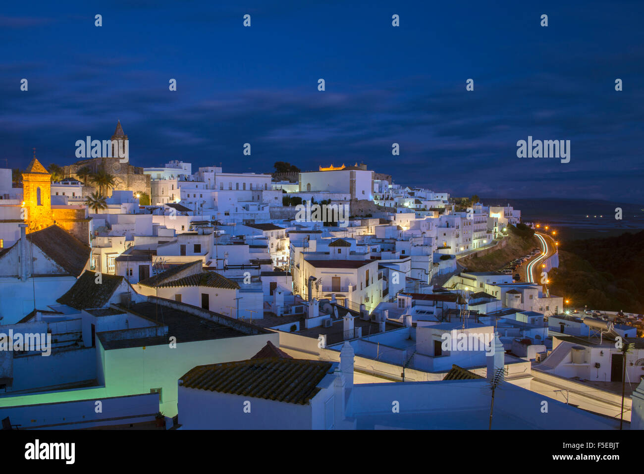 Evening rooftop views of the whitewashed village (Pueblos blanca) of Vejer de la Frontera, Cadiz province, Andalucia, - Stock Image