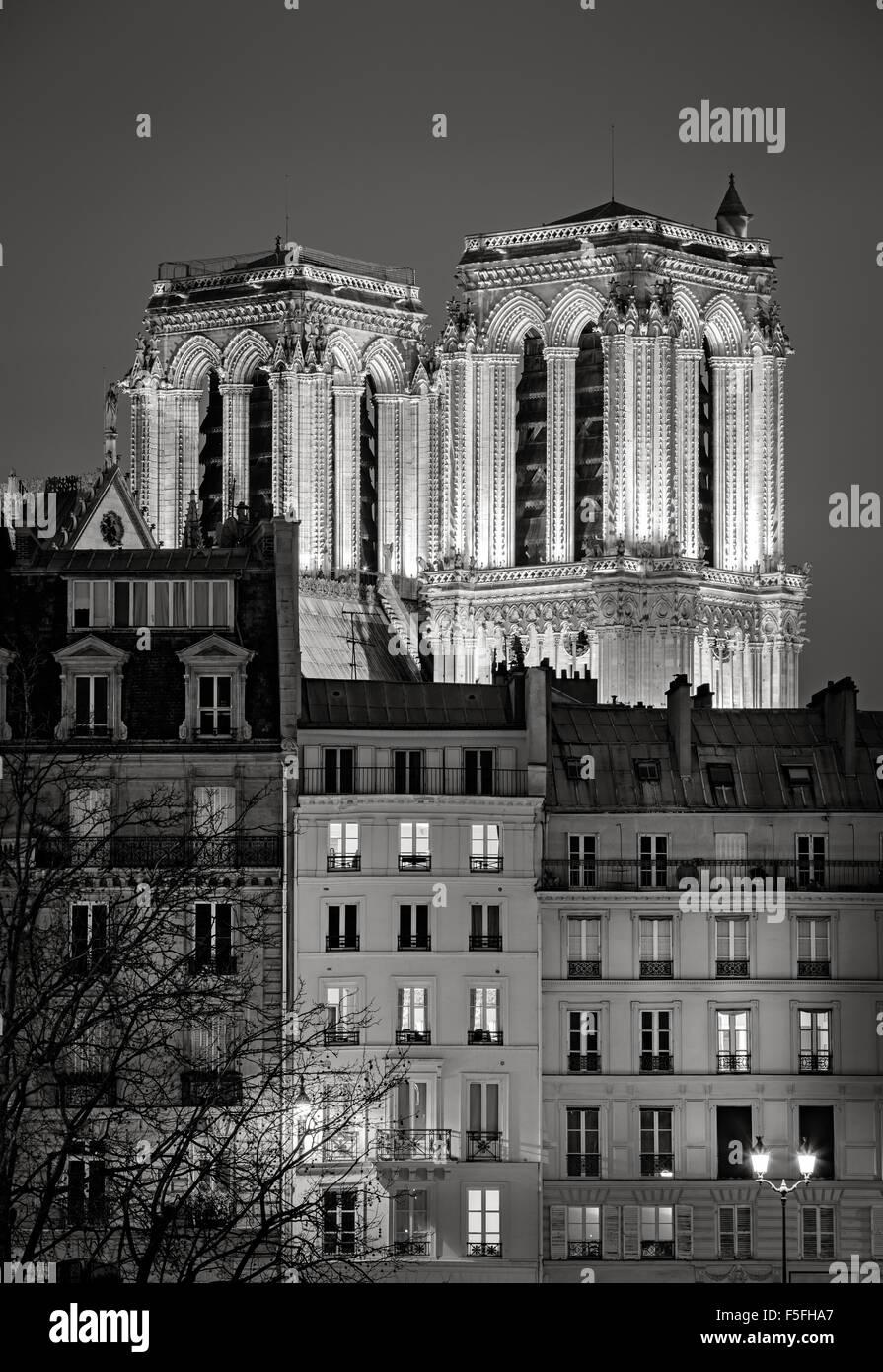 French Gothic towers of Notre Dame de Paris Cathedral illuminated at night. Ile de la Cite, 4th arrondissement, - Stock Image