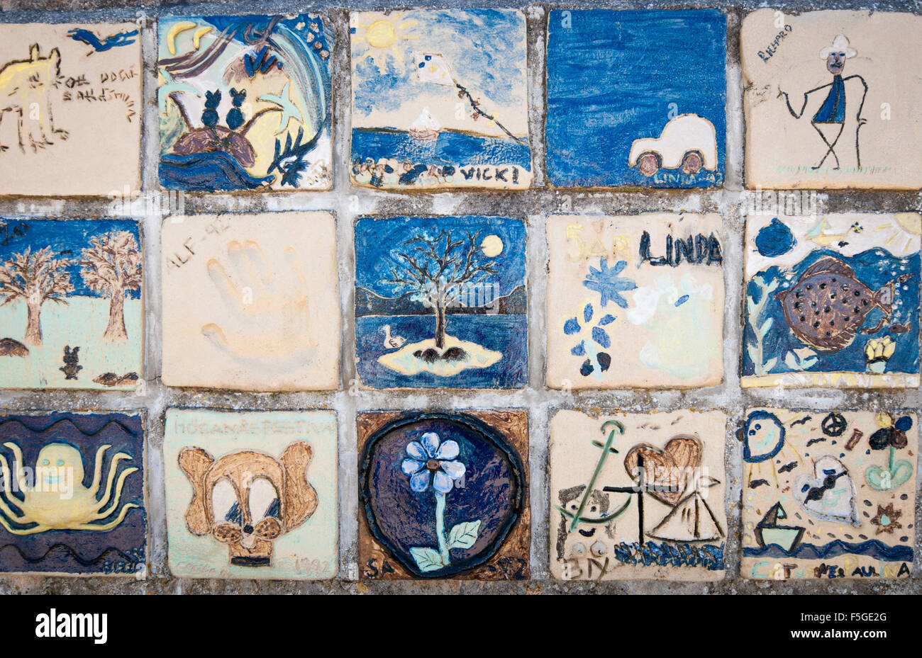 Childrens Painted Ceramic Tile Art On The Seawall In Hgans Stock