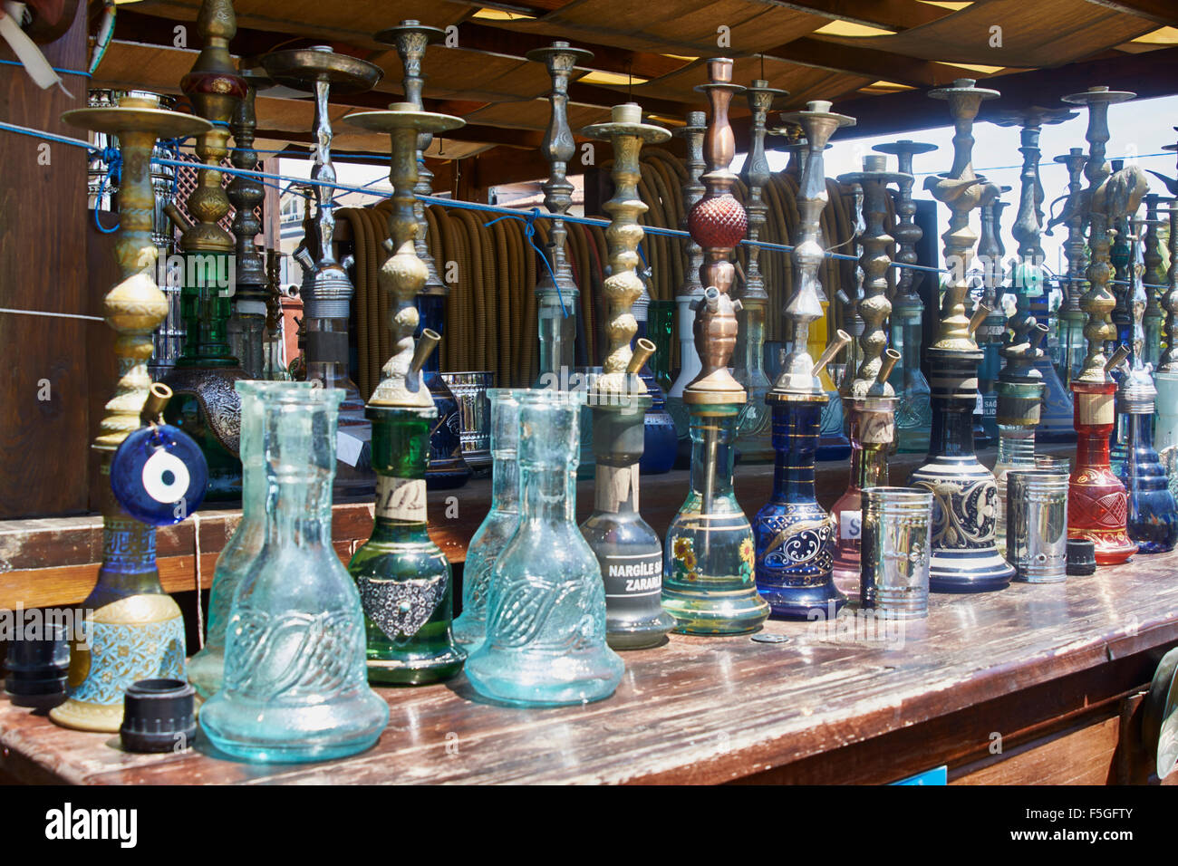Turkish smoking pipes (hookah) lined up on outdoor bar counter. & Turkish smoking pipes (hookah) lined up on outdoor bar counter Stock ...