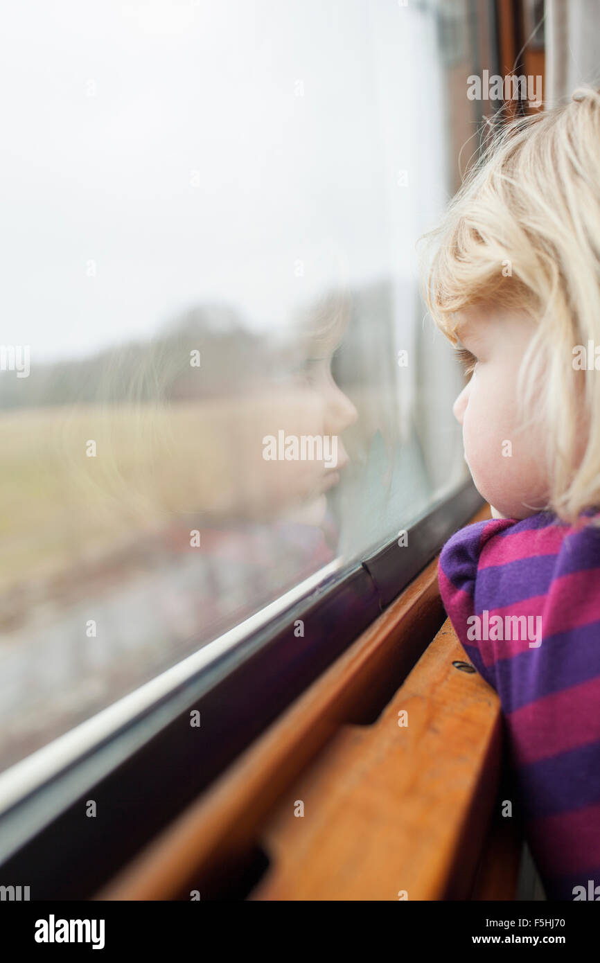 Sweden, Girl (2-3) traveling by train - Stock Image