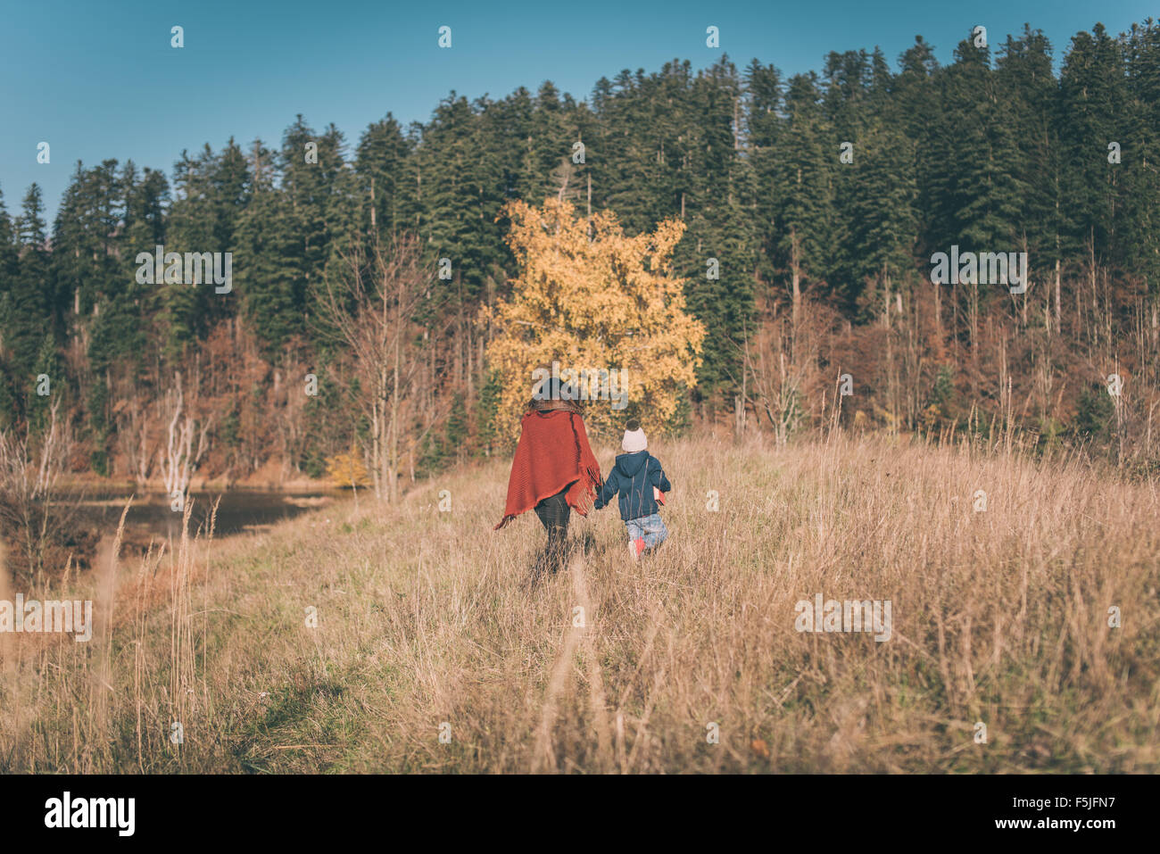 Mother and son walking in nature - Stock Image