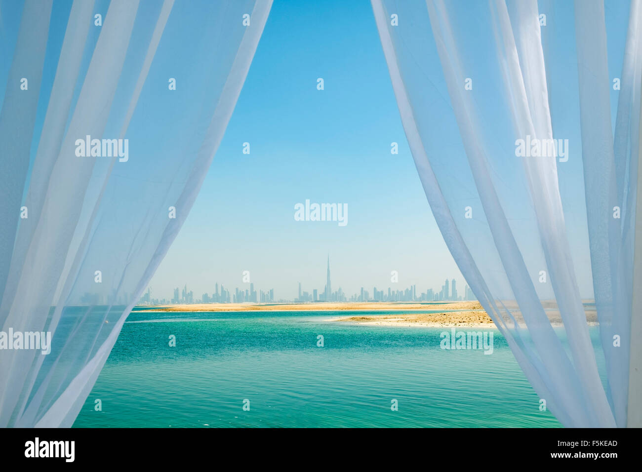 Skyline of Dubai from The Island Lebanon beach resort on a man made island, part of The World off Dubai, United - Stock Image
